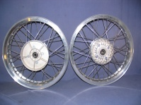 wheels, pair, 18 x 2.15 & 18 x 2.5, four bolt 280mm front/rear. stainless steel spokes